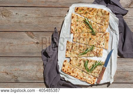 Flammkuchen, Traditional German Pizza With Red Onion, Bacon, Cream Cheese