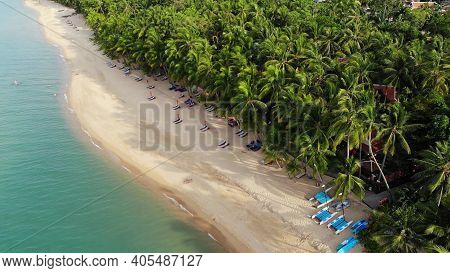 Blue Lagoon And Sandy Beach With Palms. Aerial View Of Blue Lagoon And Sun Beds On Sandy Beach With