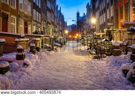 Gdansk, Poland - January 17, 2021: Beautiful architecture of the Mariacka street in Gdansk at snowy winter, Poland