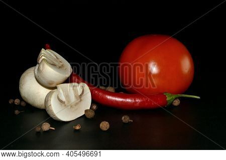 Cutted Mushroom, Red Hot Pepper, Tomato And Allspice On Black Background