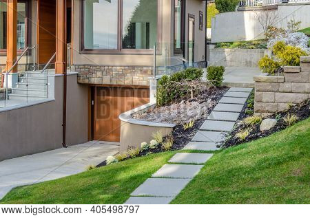 A stone stairs leading to a house with outdoor landscape in Vancouver, Canada.