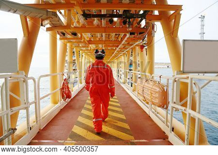 Offshore Oil And Gas Industry And Operated By Technician Petroleum. Worker Walking To Oil And Gas Pl