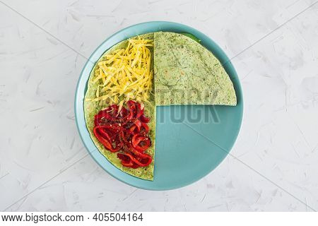 Plant-based Food, Vegan Version Fo The Viral Layered Tortilla Wrap Hack With Red Peppers Grated Dair