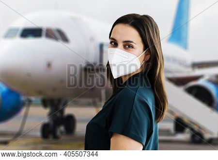 Facemask On Plane And In Airport. Travel Wearing Face Mask