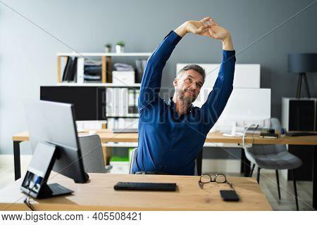 Stretch Exercise At Office Desk At Work. Stress Break