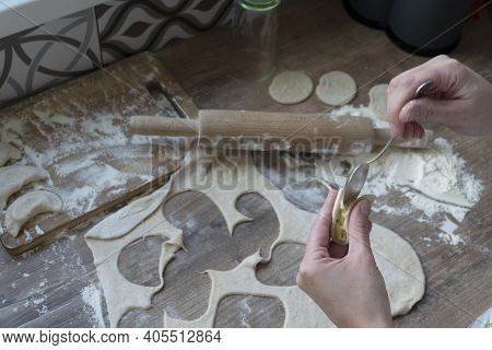 Process Of Filling Mashed Potato At A Round Rolled Piece, Woman Hands With Tea Spoon, Rolled Dough,