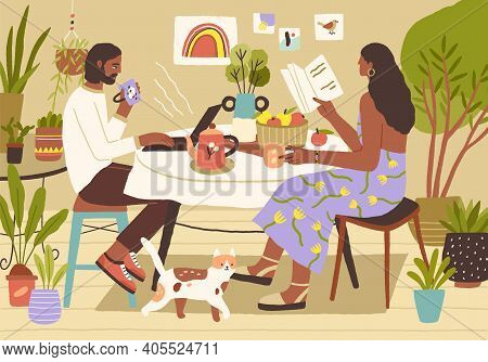 Young Couple Enjoying Spending Leisure Time At Home. Man Surfing At The Internet Or Working With Lap