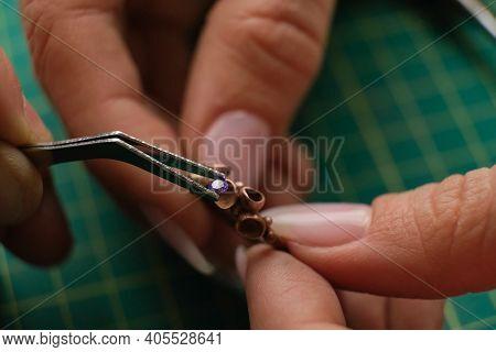 Macro Shot. Craft Jewelery Making. Ring Repairing. Putting The Diamond On The Ring. Desktop For Craf