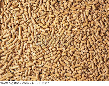 Natural Wooden Pellets Background As Renewable Energy. Close-up Wood Pellet Pattern. Top View. Flat