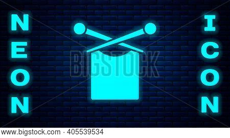 Glowing Neon Knitting Icon Isolated On Brick Wall Background. Wool Emblem With Knitted Fabric And Ne