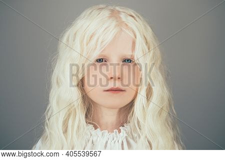Beautiful Little Girl. Child Innocence. Pure Energy. Portrait Of Sweet Peaceful Albino Blonde Angel