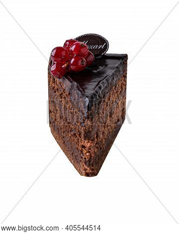 Piece Of Dark Chocolate Cake Called Mozart Decorated With Glazed Red Currant Berries. Piece Of Cake