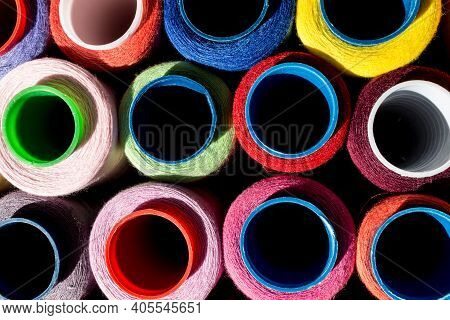 Colorful Threads In Coils, Close-up. Threads For The Production Of Sewing Products, Needlework, Hobb
