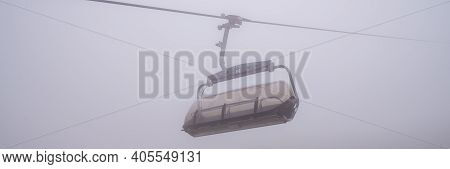 Chairlift In A Mountain Region In Summer. Life Of Ski Resort In Summertime.