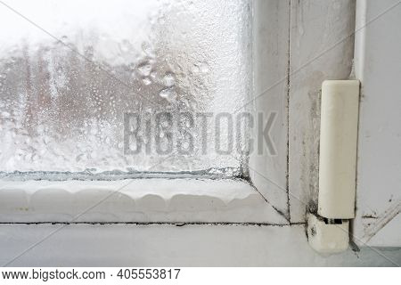 Close Up Of A Defective Plastic Window With Condensation And Freezing Inside. Poor Ventilation, High