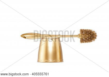 Close Up View Of Gold Toilet Brush On White Back