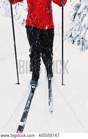 Cross-country Skiing. Person In Motion Through A Skiing Slope In A Winter Wonderland On A Bright Sun
