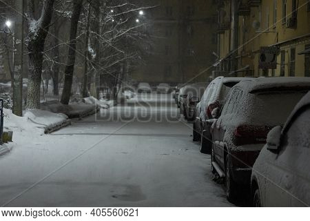 Cars In The Parking Lot Were Covered With Snow, Problems For Car Owners Due To A Heavy Snowstorm, Wi