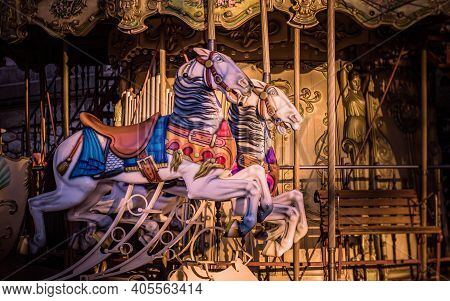 Vibrant Horses On A Traditional Carousel Funfair Ride In Montmartre, Paris, France. Taken On A Warm,