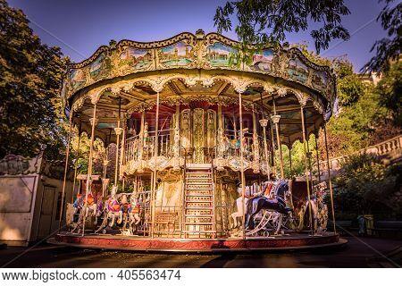 Traditional Carousel Fairground Ride In Montmartre, Paris, France. Taken On A Warm, Golden Autumn Mo