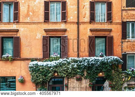 Rome, Italy - February 26, 2018: Fragment Of A Building With Foliage Under The Snow. Rome Under The