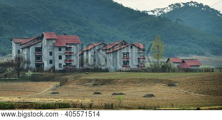 Countryside Landscape,  An Agricultural Fields And Urban Village With Typical Architecture.  All Hou
