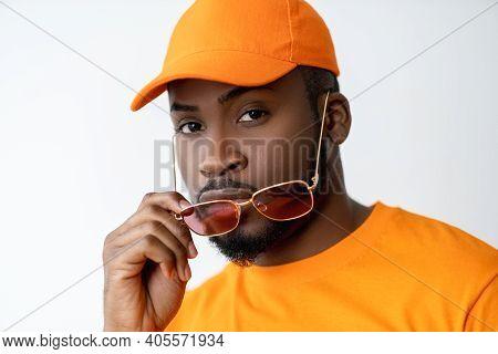 Eyewear Fashion. Summer Accessories. Optical Style. Confident African Man In Orange T-shirt Matching