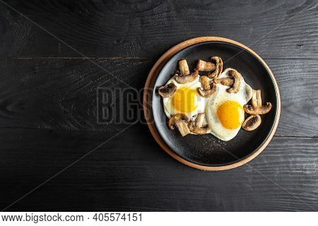 Breakfast Fried Eggs With Mushrooms. Keto, Paleo Breakfast, Healthy And Classic Brunch. Top View.