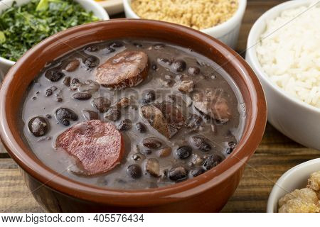 Traditional Brazilian Feijoada With Rice, Kale And Manioc Flour.