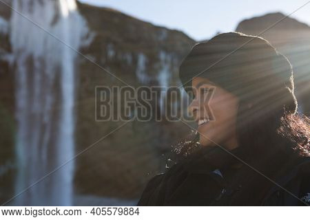 Hauyfoss Waterfall, Iceland - 03.11.2018: Travel Concept. Close Up Portrait Of A Happy African Ameri