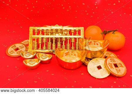 Chinese new year ornament--gold ingot and golden abacus,Chinese calligraphy on gold ingot translation:good bless for new year,Chinese characters on gold coin translation: good bless for money.