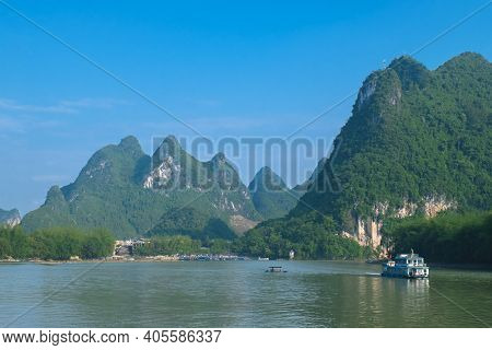 Photo Of A Boat On The River In The Guilin Region