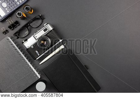 Workplace On Black Table Of A Creative Designer Or Photographer With Photography Equipment. Stylish