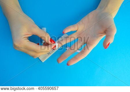 Collection Of Capillary Blood From A Finger. After Analysis, Rub The Finger With Alcohol To Stop Ble