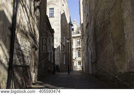 Bath, Uk - April 10, 2019. Long Shadows Cast On Alleyway In Courtyard. Bath, England, Uk, April 10,