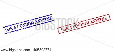 Grunge Use A Condom Anytime Rubber Stamps In Red And Blue Colors. Seals Have Distress Style. Vector