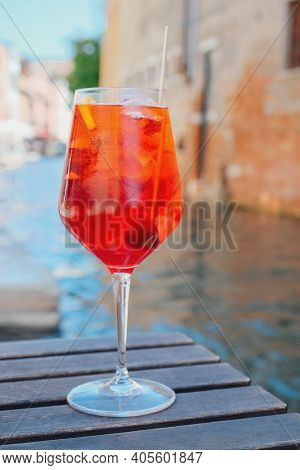 Glass Of Refreshing Aperol Spritz Cocktail Served On The Deck Bar In Venice. Traditional Venetian Ap