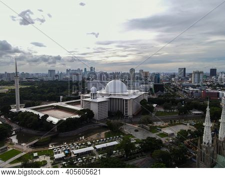 Aerial View Of Istiqlal Mosque. It Is The Largest Mosque In Southeast Asia And Noise Cloud With Jaka