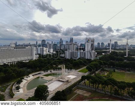 Aerial View Of West Irian Liberation Monument In Downtown Jakarta And Noise Cloud With Jakarta Citys