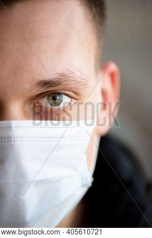 Portrait Of A Young Guy In A Protective Face Mask. New Coronavirus 2019-nkov Infection