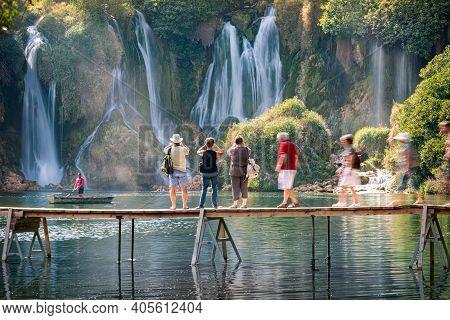 Kravice Waterfalls, Bosnia And Herzegovina - September 10, 2015: People On Bridge Taking Pictures Of