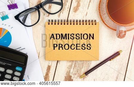 Admission Process Is Written On A Notepad On An Office Desk With Office Accessories.