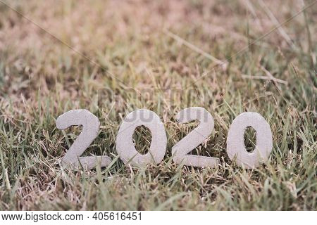 On Earth Day 2020, The Figures Cut From Paper Boxes Were Produced From Trees Placed On A Pale Yellow