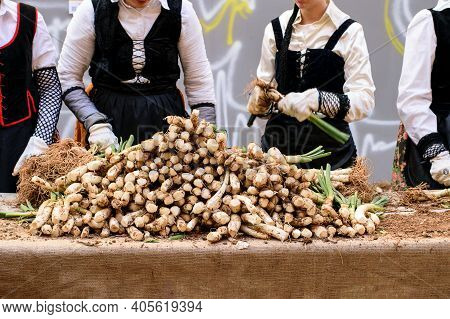 Women Clean And Prepare Spring Onion For Grill On The Market. Traditional Holiday Of Spring Onion In