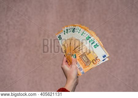 Hand Holding And Showing A Fan Of Euro Money Or Giving Money. World Money Concept, 50 Euro Banknotes