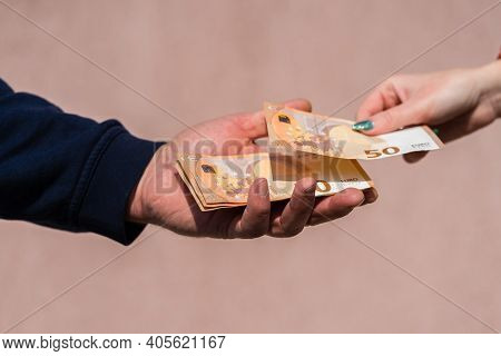 Hand Giving Money Like Bribe Or Tips Or Salary Isolated, Hard Worked Hand Taking Euro Banknotes. Cur