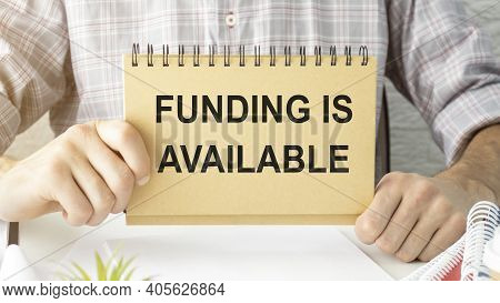 Fiinancing Available Words On Card In Businessman Hand. Finance Sponsorship Funding Business Concept