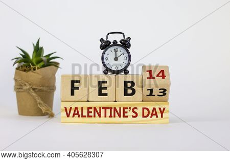February 14 Valentines Day Symbol. Fliped Wooden Cube With Words 'feb 14 Valentines Day'. Black Alar
