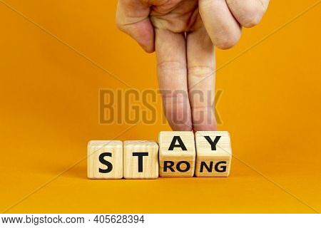 Stay Strong Symbol. Businessman Turns Cubes With Words 'stay Strong'. Beautiful Orange Background. M