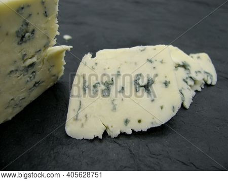 A Piece Of Cheese With Blue Dorblu Mold